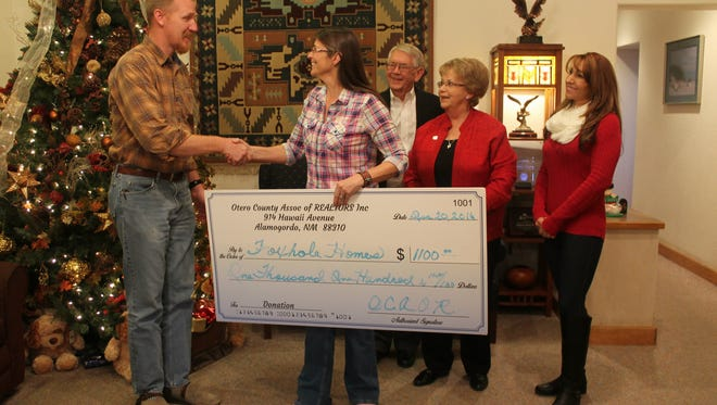 The Otero County Association of Realtors donated $1,100 to Foxhole Homes on Tuesday afternoon.