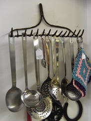 A view of some ladles and spoons hanging from the head