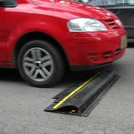 """A car goes over Decano Industries' """"smart speed bump"""" in Toluca, Mexico on Sept. 23, 2009.  (Via MerlinFTP Drop)"""