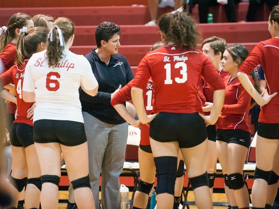 St. Philip head coach Vicky Groat talks with her players