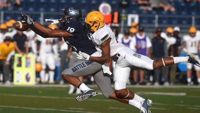 Nevada's Wyatt Demps (19) tries to make a catch while being guarded by Toledo's Calvin Bransford on Saturday.