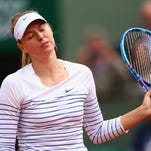 Russia's Maria Sharapova returns the ball to Czech Republic's Lucie Safarova during the women's fourth round of the Roland Garros 2015 French Tennis Open in Paris on June 1, 2015.
