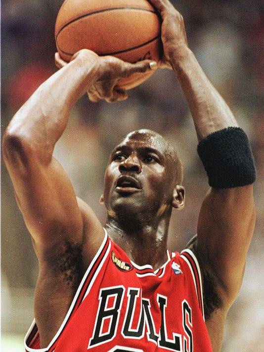 Michael Jordan of the Chicago Bulls takes a shot a