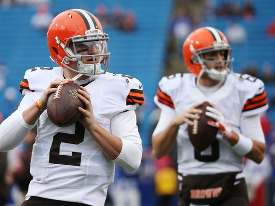Johnny Manziel #2 of the Cleveland Browns and Brian Hoyer #6 of the Cleveland Browns warm up before the game against the Buffalo Bills at Ralph Wilson Stadium on November 30, 2014 in Orchard Park, New York.