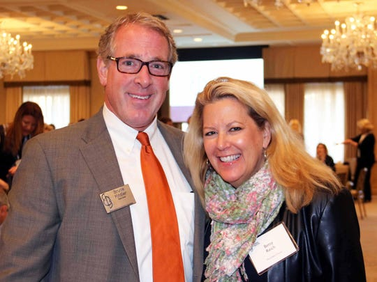 Bruce Kridler of Greenleaf Trust and Betsy Reich of the Colburn Group at Tuesday's real estate forecast breakfast in Birmingham.