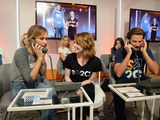 Kristen Wiig, Emma Stone and Bradley Cooper attend