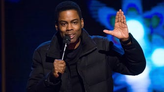 """In this Feb. 28, 2015 file photo, comedian Chris Rock performs at Comedy Central's """"Night of Too Many Stars: America Comes Together for Autism Programs"""" in New York."""