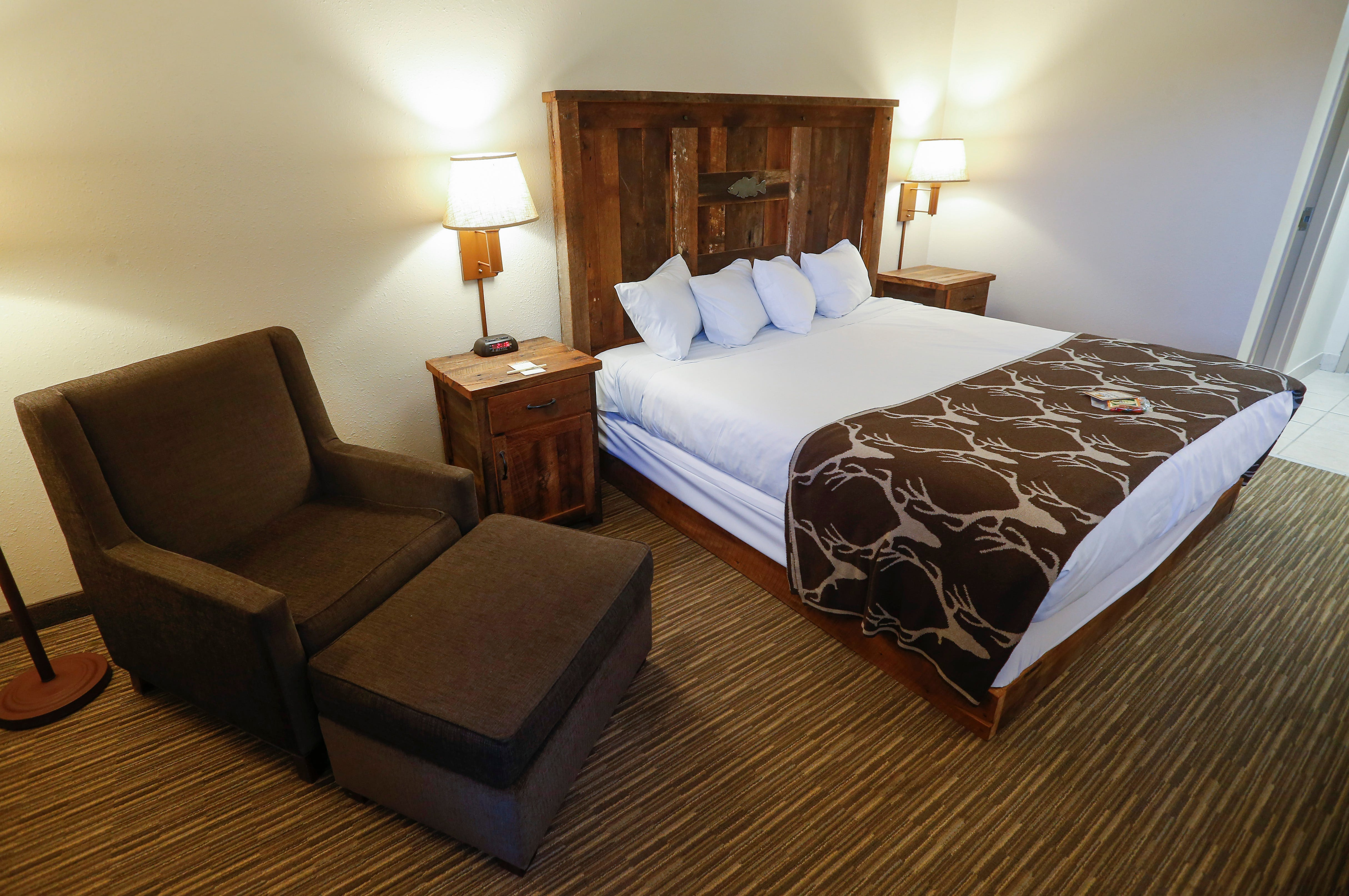 A View Inside A Room With A Single King Size Bed At