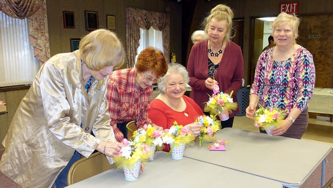 Judy Fagotti, first vice president of the Woman's Club of Vineland, was in charge of a recent craft day at the club. Participants made bouquets, which were later donated to Baker Place to be used as table centerpieces during the Easter/spring season. The club also donated a small, boxed gift for each resident. Club members (from left) Ann Starkey, Nancy Steelman, Fagoti, Dolores Misiewicz and Doris Schalick participated.