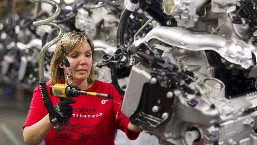 Engine Specialist Jennifer Souch assembles a Camaro engine at the GM factory in Oshawa, Ontario. GM is moving Camaro production to Lansing, eliminating 1,000 jobs in Oshawa.