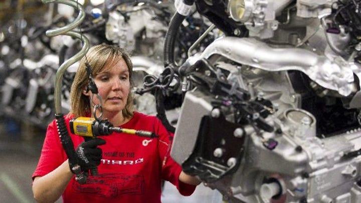 Engine Specialist Jennifer Souch assembles a Camaro
