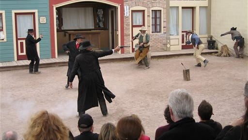 """In this 2011 file photo, actors portraying Wyatt Earp (foreground), Police Chief Virgil Earp (second left), Morgan Earp (left), and Ike Clanton, and brothers Frank and Tom McLaury shoot at each other during a performance of """"The Tragedy at the O.K. Corral"""" in Tombstone."""