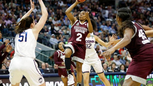 Mississippi State guard Morgan William (2) drives to the basket as Connecticut center Natalie Butler (51) defends during the first half of an NCAA college basketball game in the semifinals of the women's Final Four, Friday, March 31, 2017, Friday, March 31, 2017, in Dallas.