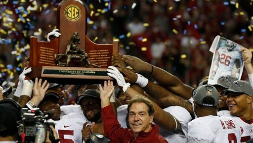 Alabama head coach Nick Saban and players celebrate after the Tide's 42-13 Southeastern Conference championship victory over Missouri in Atlanta.