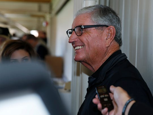 In this Nov. 7, 2015 photo, retired Colorado football head coach Bill McCartney jokes with reporters before the first half of an NCAA football game in Boulder, Colo.