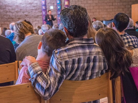 Mike Truitt and his two children, Jesse Truitt, left,