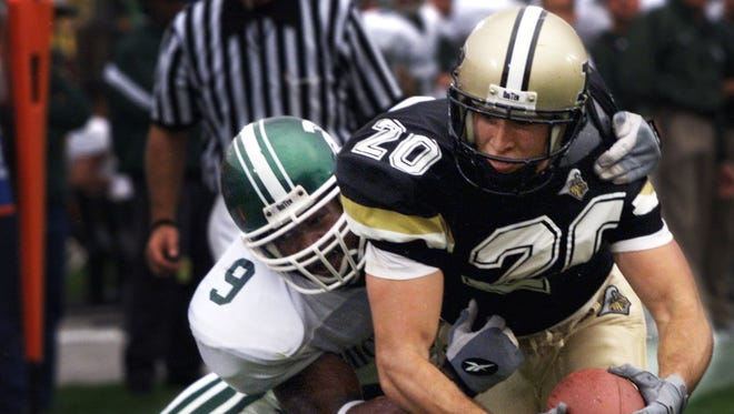 Purdue wide receiver Chris Daniels lunges for the goal line for the score as Michigan State's Aric Morris tries to stop him during the Boilermaker's 52-28 win over Michigan State Saturday October 16, 1999. Daniels set a Big Ten record for pass receptions with 21 and had over 300 yards receiving.