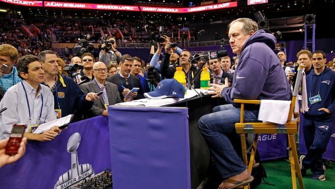 Wearing his trademark sweatshirt and flip flops, New England Patriots head coach Bill Belichick takes questions during Media Day Tuesday, January 27, 2015 in Phoenix, Ariz.