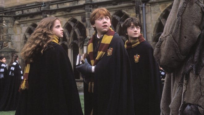 """Emma Watson (from left), Rupert Grint and Daniel Radcliffe are back for a second year at Hogwarts in """"Harry Potter and the Chamber of Secrets."""""""