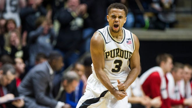 Purdue's P.J. Thompson (3) celebrates after scoring a three-pointer during the first half of an NCAA college basketball game against Wisconsin Sunday, March 6, 2016, in West Lafayette, Ind. (AP Photo/Robert Franklin)