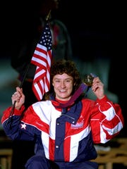 American Bonnie Blair displays her gold medal after