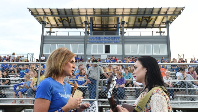 Michelle Padgett, left, talks with Morgan Bennett at Bomberfest Friday night. Bennett was there to sing a song during the dedication of the Hayden Padgett Memorial Press Box at Bomber Stadium. The press box is named after Michelle and Brian Padgett's son Hayden who died in December of 2011 following a battle with brain cancer.