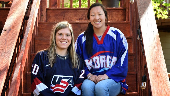 In this May 11, 2017 photo, sisters Hannah, left, and Marissa Brandt, pose at their family's home in Vadnais Heights. Minn. The pair will be playing in the upcoming Winter Olympics in women's hockey, Hannah for the U.S. and Marissa for South Korea. (Scott Takushi/Pioneer Press via AP)