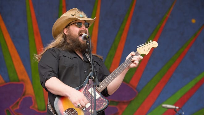 Chris Stapleton performs during the New Orleans Jazz & Heritage Festival on May 2, 2015, in New Orleans. (Photo by Amy Harris/Invision/AP)