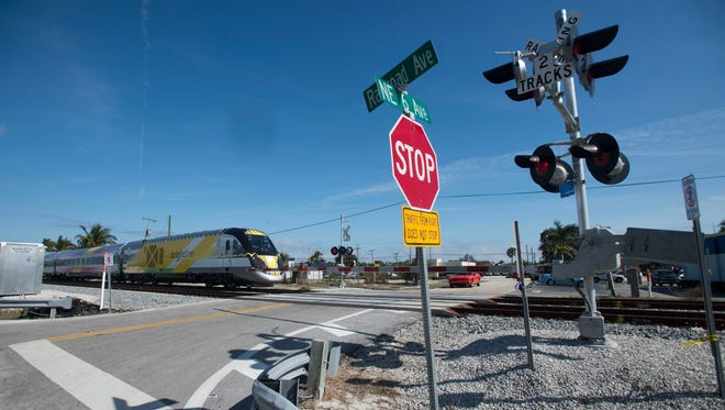 "Brightline trains continue service between West Palm Beach and Fort Lauderdale, seen on Thursday, Jan. 18, 2018 in Boynton Beach. Two people have died in a week being hit by Brightline trains in Boynton Beach. ""Stop victim blaming and take responsibility for the fact your trains are killing people,"" said U.S Rep. Brian Mast on Thursday."