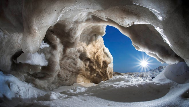 """Montanus, 53, took this photo of an """"ice cave"""" on Lake Ontario. """"I stumbled upon this cavernous ice cave last night while out shooting. I've never seen one this big...."""" he posted on March 11."""