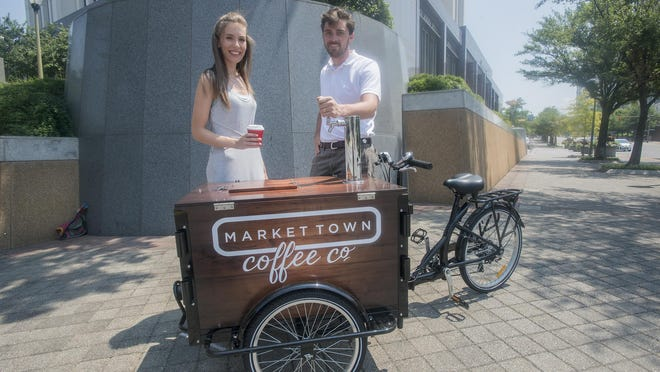 Laura Jean Bell and Cody Bell are the owners of Market Town Coffee Co., which opens on Monday. Their cart will be located outside the RSA tower on the corner of North Lawrence and Monroe in downtown Montgomery.