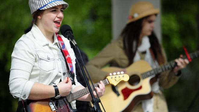 Gracie Babineaux, left, plays guitar with the Babineaux Sisters Band.