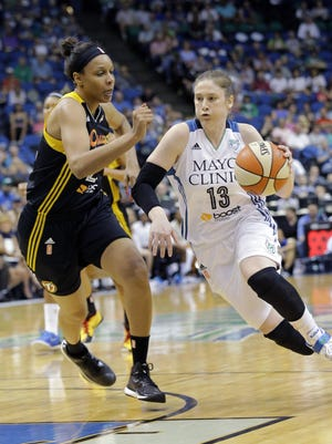 Minnesota Lynx guard Lindsay Whalen (13) drives to the basket against Tulsa Shock forward Plenette Pierson, left, in June 2015 in Minneapolis. Whalen had a game-high 26 points as the Lynx won 83-75.