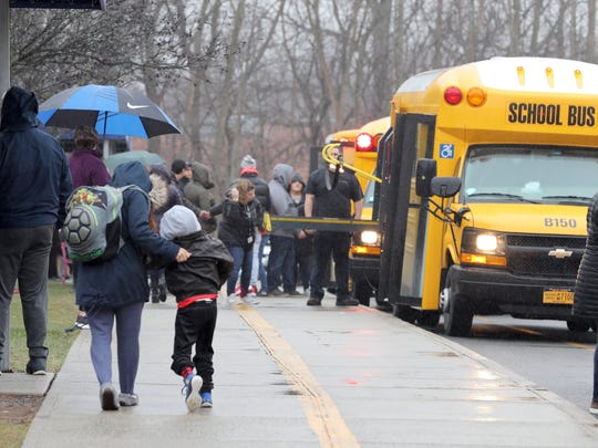 Students arrive at the Jesse Kaplan School in West