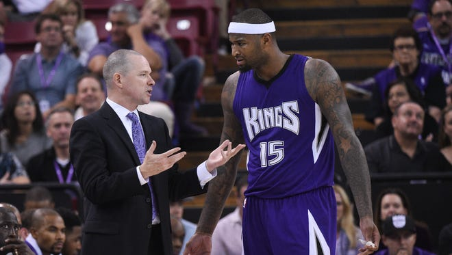 Michael Malone, now fired, coaches Kings center DeMarcus Cousins in October.