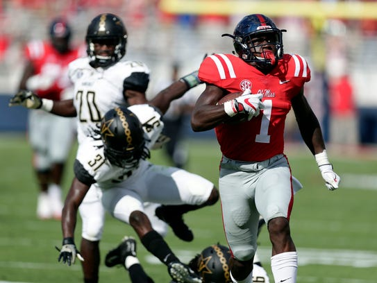 Mississippi wide receiver A.J. Brown (1) runs past