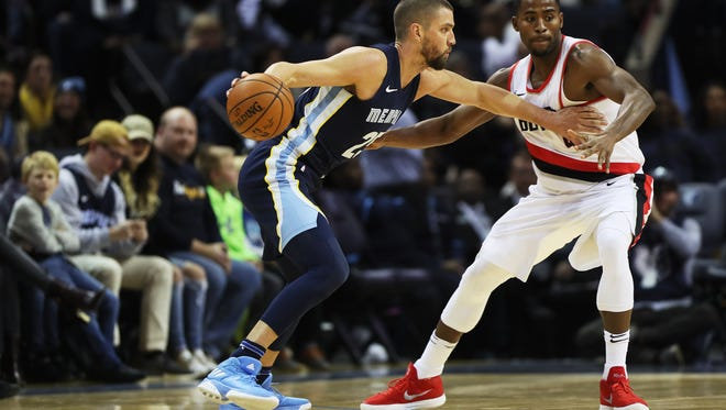 November 20, 2017 - Memphis Grizzlies forward Chandler Parsons (25) looks for an open teammate while being guarded against forward Maurice Harkless (4) of the Portland Trail Blazers during the first period at FedExForum on Monday.