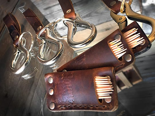 Hand-tooled leather key rings and toothpick holders are just some of the goods available at Warfleigh Barber & Supply Co.