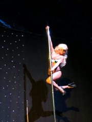 Pole Dancer Heather Hill performing to applause at Christmas in the Sky.