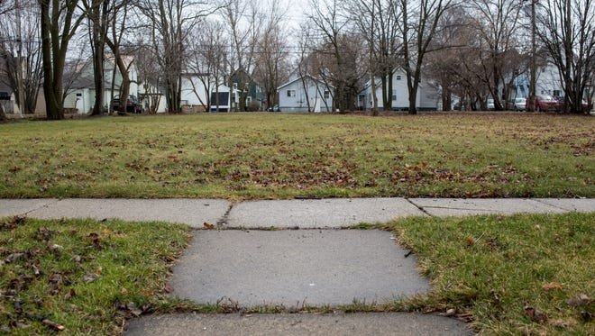 """The Port Huron Housing Corporation is donating three lots in the 900 block of Howard Street to Blue Water Habitat for Humanity as part of an effort to revitalize the neighborhood. Habitat is hoping to be awarded a $500,000 through a national """"Project Reinvest: Neighborhoods"""" grant, which would fund development of the project."""