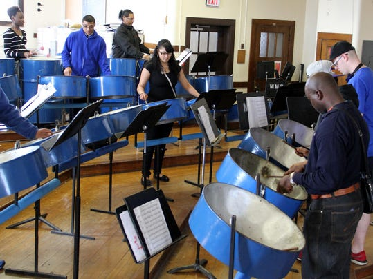 Vernon Henry with students in the Band Room at Monroe High School