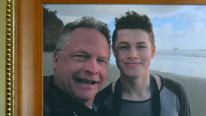Photo of David Huntley with his son Henry taken before his death at age 19.