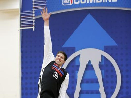 Doug McDermott, from Creighton, participates in the standing vertical jump at the 2014 NBA basketball draft combine Friday, May 16, 2014, in Chicago. (AP Photo/Charles Rex Arbogast)