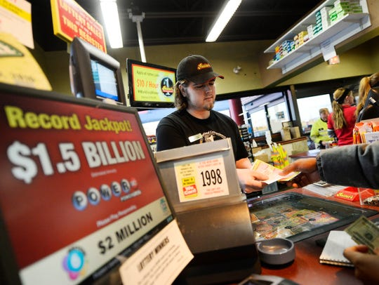 Shift manager Chris Rydberg sells lotto tickets at