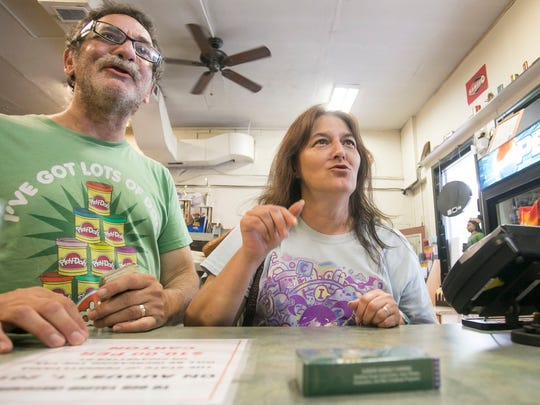 Howard and Linda Auerbach, of Queens, New York, talk with Smoker's Outlet store owner Esther D'Ottavio about the new taxes on cigarettes Thursday, July 28, 2016. Starting Monday, Aug. 1, 2016, cigarette taxes will increase by $1. Amanda J. Cain photo