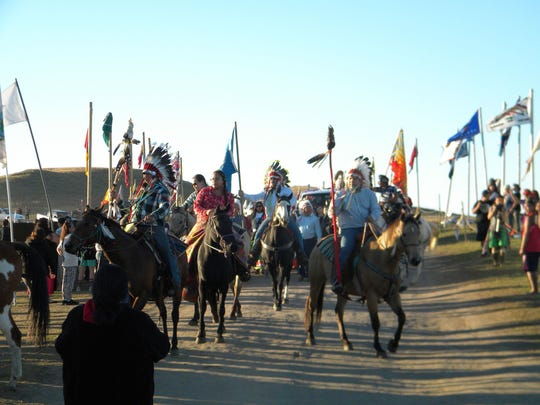 Riders lead the Fort Peck tribal delegation into the Oceti Sakowin (Seven Council Fires) Camp on the Standing Rock Indian Reservation Wednesday. Several hundred tribes have come to the camp to protest the Dakota Access Pipeline, which will be partially constructed underneath the Missouri River.