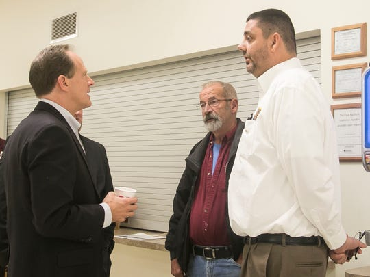 Senator Pat Toomey, left, chats with Alert Fire Company member Douglas Freeze, right, of Emigsville and retired Strinestown Fire Department Chief Steve Tawney, middle  after his press conference at Strinestown Fire Company Wednesday, Nov. 2, 2016. Amanda J. Cain photo