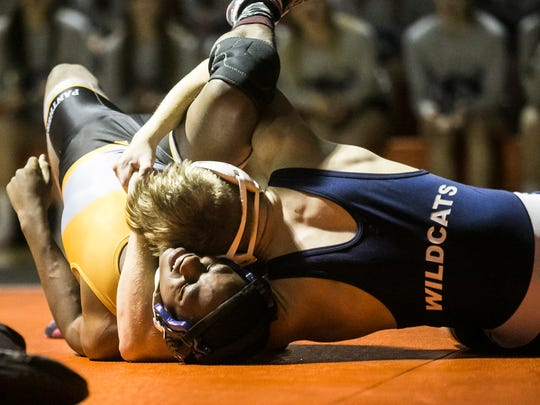 Dallastown's Jarrett Feeney, pins Central York's Chase