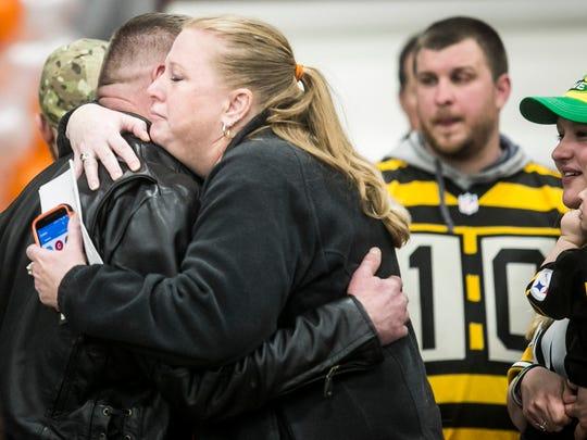 Beth Wolfe, of Springettsbury Township, hugs Bill Kohler, during the viewing services for Ayden Zeigler-Kohler Saturday, April 1, 2017, at Utz Arena. Amanda J. Cain photo