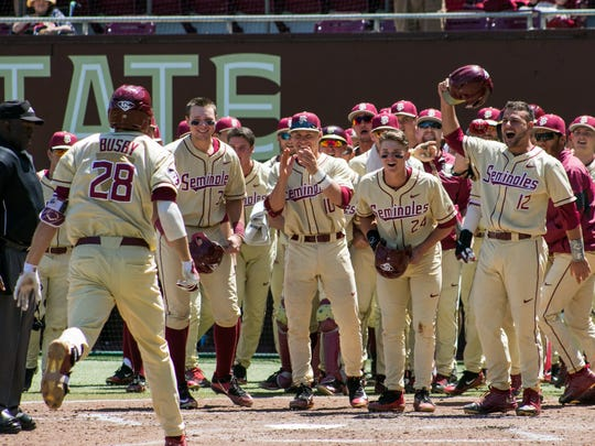 Florida State junior third baseman Dylan Busby celebrates a three-run homerun during the third inning of the Seminoles 7-3 victory over Clemson on Sunday afternoon at Dick Howser Stadium.